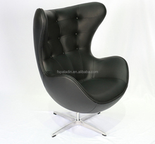 Button Tufted Black Leather Egg Shaped Swivel Chair