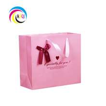 2018 alibaba china custom luxury pink paper gift bag with bow tie ribbon