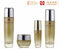 Luxury packaging matt gold color empty cosmetic sets spray glass bottle with pump HY1284