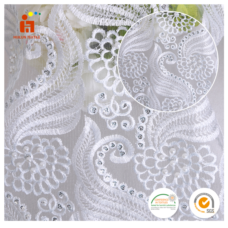 2017 Hot selling 100 polyester white knitted plain silver sequin fabric for garments