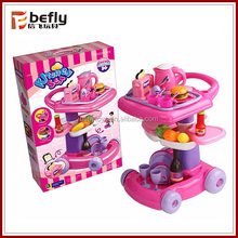 Funny pink toy trolley kitchen set