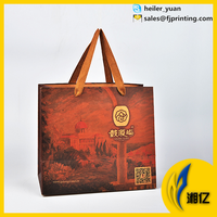 Printed gift paper bag with ribbon handle