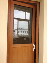 Reasonable price high quality wooden color casement laminated upvc doors