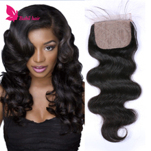 Top quality and beautiful indian virgin human hair body wave silk based closure with baby hair natural color
