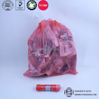 Plastic drawstring garbage bag on roll for packing trash