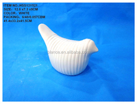 white bird figurine in white bird decoration