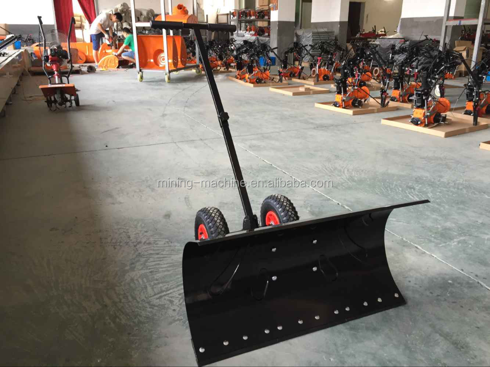 snow plow shovel with wheel