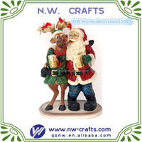 happy Santa Claus and funny reindeer figurine christmas winter