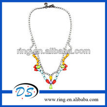 Multicolored crystal necklace from Tom Binns featuring a neon design