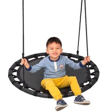 Round safe outdoor nest baby swing chair at yard