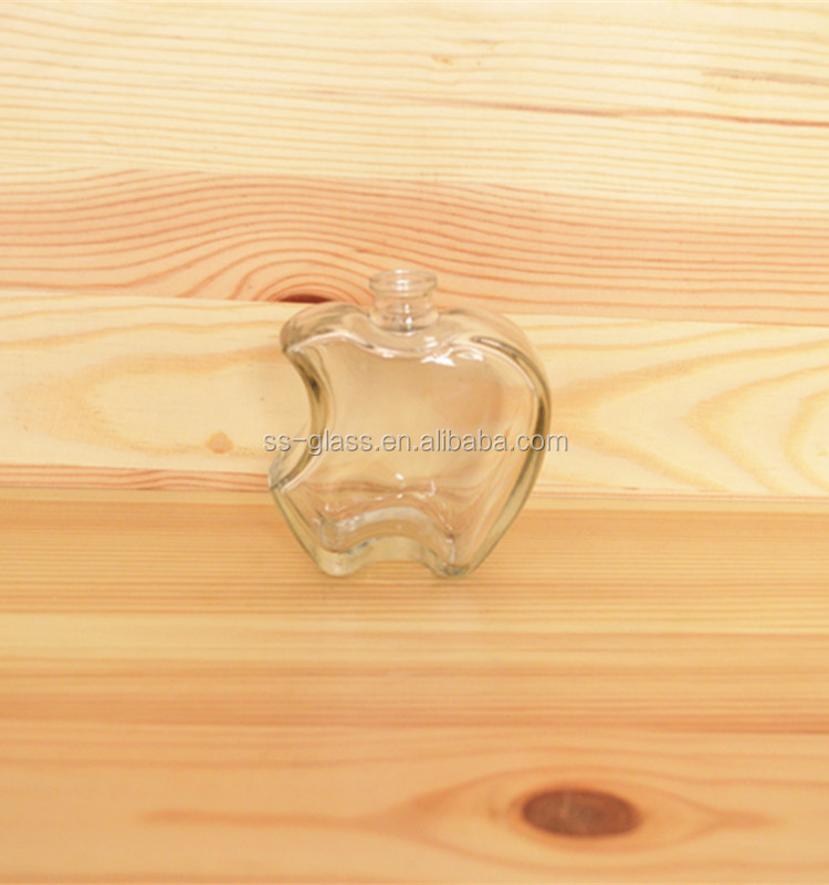 Apple shape fancy glass bottles 100ml perfume glass bottles with stopper factory price