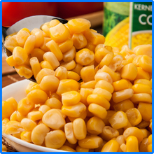 canned sweet kernel corn with plastic spoon