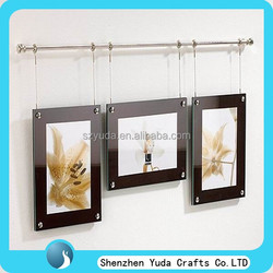Beautiful acrylic magnetic poster frame with black back hanging on the wall
