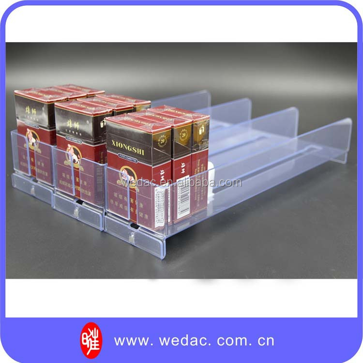 Retail shelf pusher for cigarettes