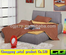 Bed with linen fabric surface