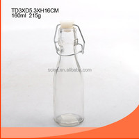 clear mini milk bottle with white swing top lid