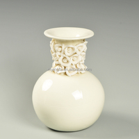 Small cheap white ceramic hand-made flower vase