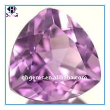 Stunning fat triangle shaped violet Cubic Zirconia