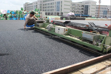 spray coating system running track pave machines