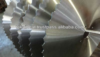 Saw blade body fabrication with heat treating and tensioning