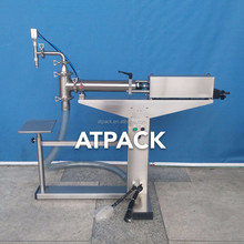 Atpack high-accuracy semi-automatic Vittel Mineral Water Premium Mineral Water 600 ml filling machine with CE GMP