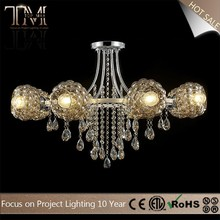 warm light chrome metal crystal and glass hotel chandelier