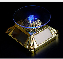 New popular Solar Powered Rotating Jewellery Mobile Phone Ring Bracelet Watch lotus Display Stand