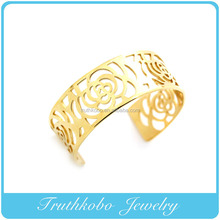 SALE Cheap Vacuum Plating Gold Laser Cut Flower Bangle Stainless Steel Rubber Band Bracelet Patterns Design For Women