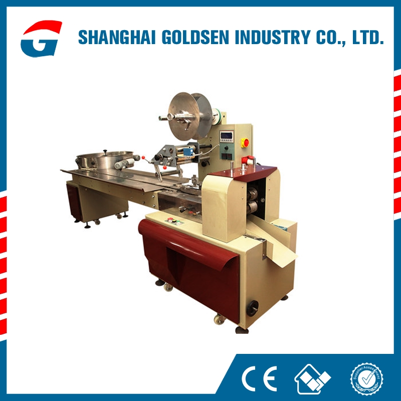 sweets wrapping machine,automatic lollipop packing machine,high quality sweets packaging machine