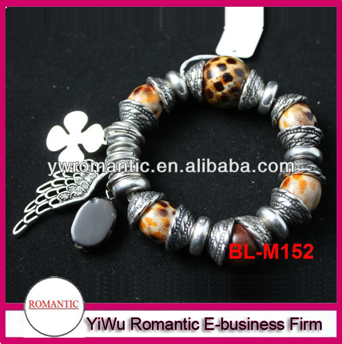 Fashion wings and ball charms antique silver bracelet