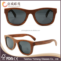 Dark Bamboo Wood Sunglasses by SHADES of BAMBOO free logo