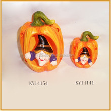 ceramic pumpkin with witch for halloween decoration