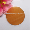 Manufacturer of synthetic round orange colores cat eye stone