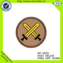 Wholesale sword logo embroidered patch with adhesive back