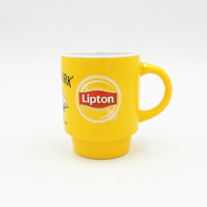 Yellow stacked ceramic mug advertising coffee cup with lipton decal