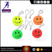Factory customized reflective custom made pvc key keychains with smlie face