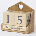 Cute handmade wooden calendar with cubes and sticks