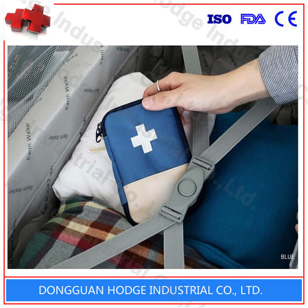 Person outdoor emergency red cross first aid kit