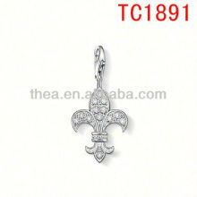 Diamond fleur-de-lis charms pendant playful ornamentation