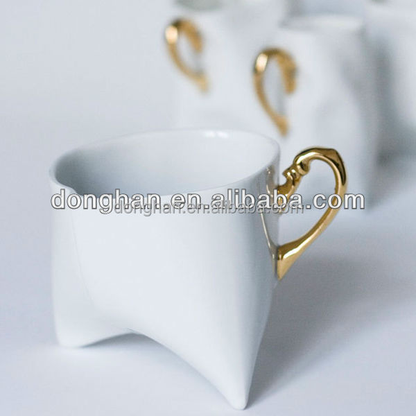 tooth shape ceramic cup with golden handle for custom