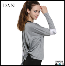 European New Fashion Lady Fitness Sportswear Tops Unique Bandage Yoga Women Casual Long Sleeve T shirt