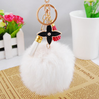 Genuine Rabbit Fur Pom Poms Keychain with Four Leaf Clover and Leather Tassels
