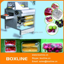 Automatic cling film tray meat packaging machine
