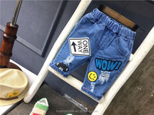 wholesale stock cartoon smiley face print destroyed broken holes cropped denim trousers frayed trim boy fifth denim kids jeans