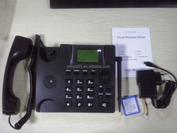 Etross or OEM brand FWP6188 GSM telephone set with antenna and backup battery