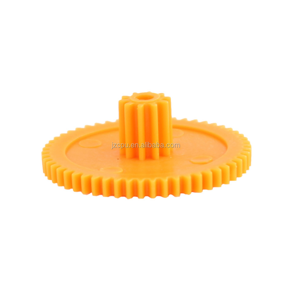 Custom yellow plastic ring gear for printer and shaft