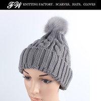 2016 fashion winter warm twist hat with revers and fake fur pompoms
