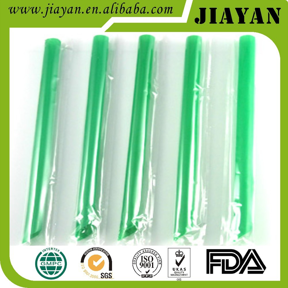 green plastic drinking straw