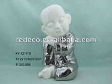 Porcelain baby buddha statue
