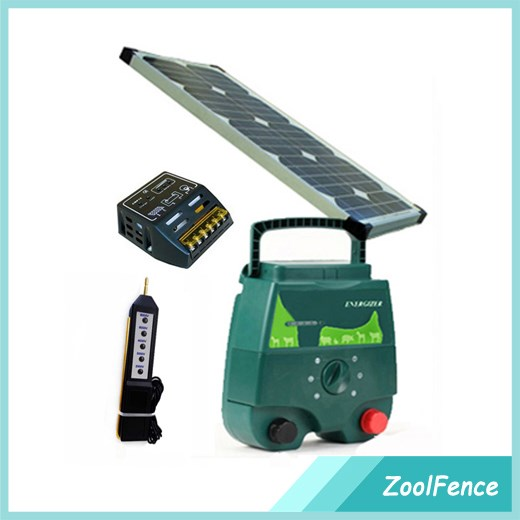 Portable solar electric fence energiser charger with 5 Joule energy output on fence line with voltmeter